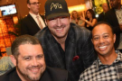 Phil Hellmuth s Tigerem Woodsem